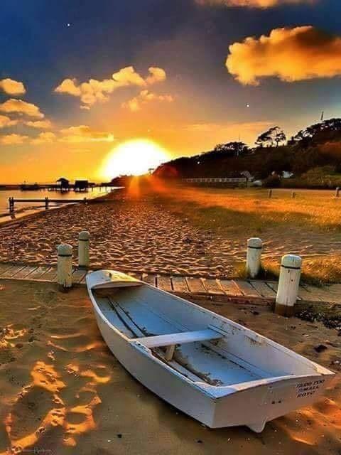 Coucher de soleil, barque